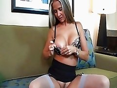 Nasty brunette with huge tits in sexy underwear gives head