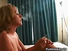 Horny blonde chick smoking a sigarette part1