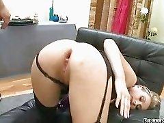 Blonde slut in garter belt and stockings gets dildo up her ass