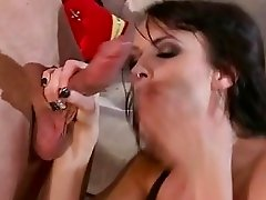 Captivating brunette with big hooters in black boots gives blowjob
