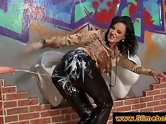 Clothed woman rubs in cum at gloryhole