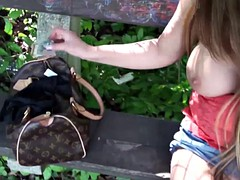 babe sitting on a bench sucks guy dick for the money