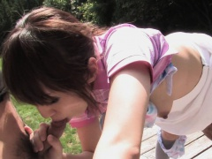 Blowing that fat dick as the sun shines on her Asian face