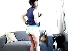 Thick brunette tranny strokes her dick on a casting couch