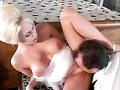 Busty blonde stripped of corset and ass fucked