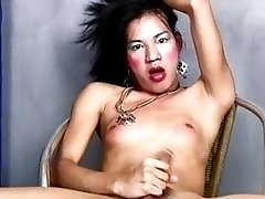 Asian ladyboy loves to beat her meat on camera