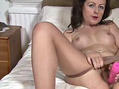 sexy mom masturbates in a bedroom