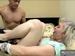 Blonde tranny gets her asshole screwed hard on the bed