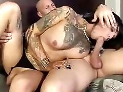 Busty inked shemale screams while her ass is roughly pounded