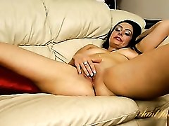 Curvy mom spreads her legs to masturbate erotically