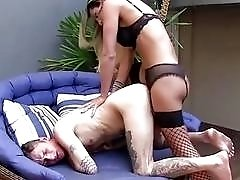 Nerdy shemale in fishnets gets penetrated by a stud