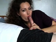 Enticing amateur mom wraps her luscious lips around a cock