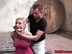 Blonde BDSM submissive restrained and gagged by freaky dungeon master