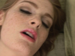 Redhead fingering on the couch