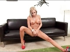 Long legged blonde with sexy fake tits
