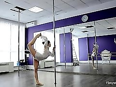 Naked ballerina climbs the silver pole effortlessly