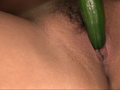 japanese bitch fucks her moist, hairy cunt with a giant cucumber