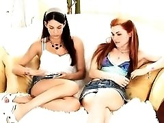 Dirty teens Jayme and Tiffany get naughty on the couch.