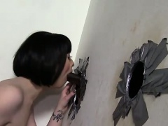 Busty slut sucks at gloryhole