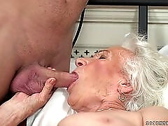 Horny granny gets her pussy serviced by a young guy