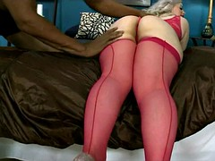Naughty platinum blonde in red stockings devastated by a bbc