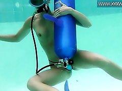 Pool scuba diving girl sucks on a dildo