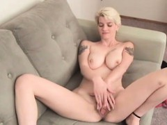 Heavily tattooed blonde Zenia has a nice big pair of boobs
