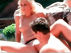 Sunny day blowjob from blonde by the pool