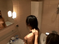 Playful European girls engage in lesbian fun in the bathroom