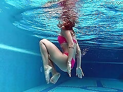 Skinny bikini girl gets naked and shows off her ass underwater