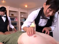 Two sexy Asian masseuses work their lovely hands on a dick