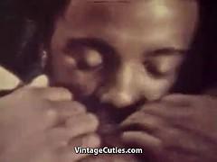 Interracial couple having oral and vaginal pleasures (vintage)
