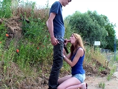 Slim babe sucks a dick and gets rammed from behind outside