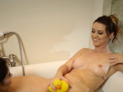 Lesbian beauties playing with their rubber duck