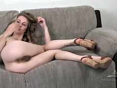Nasty babe with hairy twat masturbates on sofa