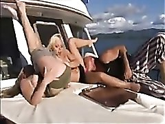 Two slender ladies fucked hard on a boat
