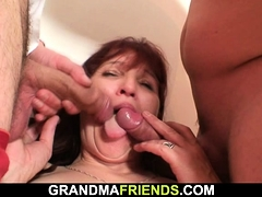 Old mature woman swallows two cocks at once