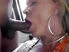 Seductive ball licking action with a horny shemale cougar babe