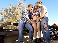 Cowgirl Ash Hollywood pounded by two men outdoors.