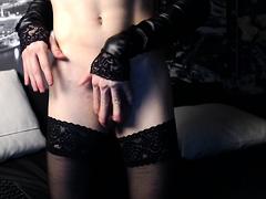 Slim brunette tranny in stockings jerks off her meat pole