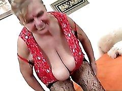 Granny fondles her big fat tits in solo porn