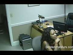 Dark chocolate amateur babe gives blowjob in office