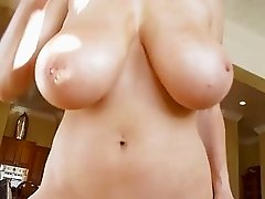 Teasing blonde milf with massive tits does handjob in pov