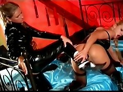 Lesbian girls in latex on bed