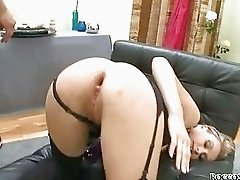 Blonde slut in garter belt and stockings gets dildo up her ass
